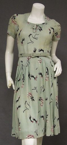 Vintageous, LLC - AWESOME Masquerade Novelty Print 1940's Day Dress, $49.00 (http://www.vintageous.com/awesome-masquerade-novelty-print-1940s-day-dress/)