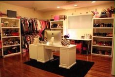 Walk in closet with computer desk... Every girls dream!