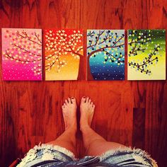 Four canvas paintings of a tree through the changes of seasons.