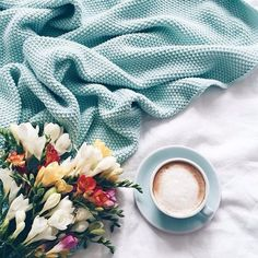 Beautiful coffee cup tones in with the blanket used in this flatlay.
