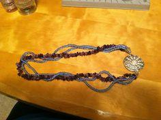 Purple necklace.