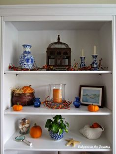 Blue and white with orange - decorating office shelves for fall