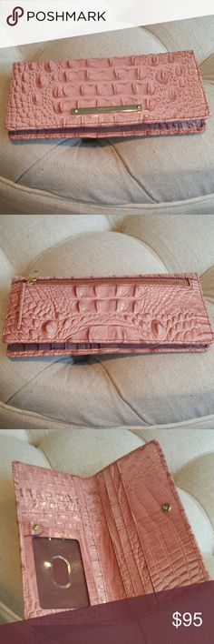 Brahmin wallet Beautiful wallet by Brahmin zip pocket on the outside plenty of room on the inside for credit cards ID cash excellent condition comes with registration card color is Marquis Melbourne really lovely Brahmin Bags Wallets