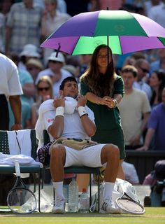 Serbia's Novak Djokovic sits with a towel of ice on his head during the Wimbledon men's singles final. Picture: Adam Davy/PA Wire