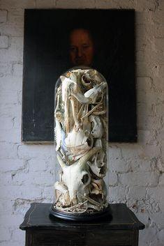 http://www.ebay.co.uk/itm/Antique-Unique-Skull-Skeletal-Fragment-Sculpture-in-a-Victorian-Glass-Dome-/281574077815?pt=LH_DefaultDomain_3