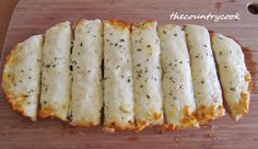 Cheesy Garlic Bread-starting from a store-bought loaf of bread: 1 stick butter softened to room temp.   3 cloves garlic, finely minced  1 1/2-2 cups shredded mozzarella cheese  1/4 cup mayonnaise  1/2 loaf italian or french bread  dried parsley flakes (optional)