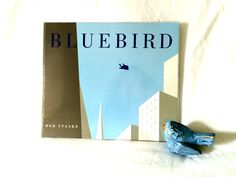 Title: Bluebird Author/Illustrator: Bob Staake Age Group: 2-8 Synopsis: A bluebird befriends a lonely boy and they share a magical day together but when a tragic accident takes the bluebird's life the boy learns that true friends never die. The Low Down: There are some stories that we read and Bug loves because they're silly …