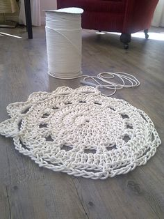 A crocheted rug made with upholstery piping.