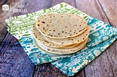 Paleo Tortilla  Ingredients: - 1 cup blanched almond flour - 1 cup tapioca flour - 1/2 tsp. sea salt - 4 Tbsp. light olive oil - 6 Tbsp. warm water