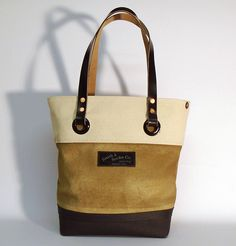 """Hand dyed cotton canvas tote bag - sand with black leather strap ● Size: 5,5"""" x 11"""" x 14,2"""" - American ●  14 cm x 28 cm x 36 cm - European ●  In case of order, please contact us with the following e-mail address: info@smithandscribeco.com #cottoncanvas #totebag #handmadeineurope #handmade #bag #1920's #1930's #1940's #italianleather #premiumingredients Scribe, Italian Leather, Canvas Tote Bags, Cotton Canvas, Black Leather, American, Street, Handmade, Vintage"""
