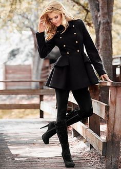 Great peplum coat. Will have to keep something this in mind for next winter. Also like the military buttons on the front.