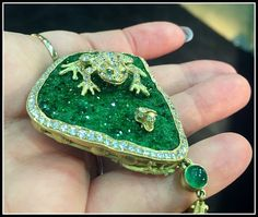 Anthony Lent Coqui pave frog pendant with golden snail friend. With diamonds, Uvaravite drusy, and cabochon emerald.