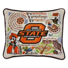"This original design celebrates Oklahoma State University. Go Cowboys!  This pillow is embroidered on a light tea-color cotton cover that zips off for cleaning and accented with black piping.  16x20"" size"