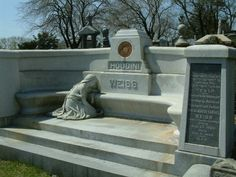 Gravesite of Harry Houdini world famous magician - located in Queens, NY it has the crest of the Society of American Magicians inscribed on it. Every November since he died, the Society holds a broken wand ceremony at his gravesite