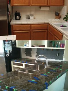 Goodbye white tiles! Only $500 to redo the counters with granite tiles.