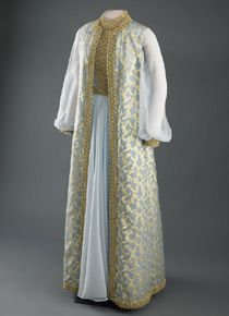 Rosalynn Carter wore this blue chiffon evening gown and sleeveless coat trimmed with gold embroidery and braid to the 1977 inaugural balls. She wore the same dress six years earlier when Jimmy Carter became governor of Georgia. It was designed by Mary Matise for Jimmae.