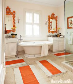 """Pagoda mirrors and Serena & Lily dhurries give """"a little jolt"""" to the master bath. Kohler tub with Waterworks fittings."""