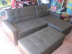Chocolate vinyl 3 seater with chase and storage ottoman. It's a sofa bed like you've never seen. Folds down to king size bed. Hardly used, moved from Perth to smaller house and we don't have room. Please text first contact.