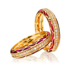 Cellini Jewelers 'Genuine Delight, Garnet' Ring by Wellendorff  Genuine Delight, Garnet' spinning band ring in changing tones of soft red cold enamel with a central row of brilliant diamonds. Handcrafted in 18-karat yellow gold; interior is engraved with your personal winged guardian angel.