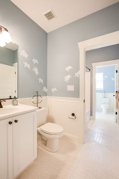 Master Bathroom with penny tile floors, interior wallpaper, Wainscoting, Paintable White Beadboard, Limestone counters, Flush