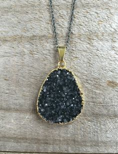 FLASH SALE - was $88, now $64 for a limited time only!  Glittering druzy hangs freely on an oxidized sterling silver cable chain. This necklace is so sparkly and pretty, and right on trend with the mixed metal look. Natural jasper quartz druzy pendant is is 100% natural, meaning it has not been color treated or enhanced in any way. Stones are wrapped in gold leaf for a polished finish - the backs are left natural to allow light to pass through. Available in a medley of rich colors, choose…