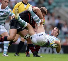 Will Fraser and Charlie Hodgson tackle London Irish's Thomas O'Leary