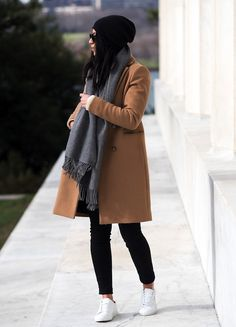 black beanie, grey scarf, camel coat, skinny black jeans and white sneakers