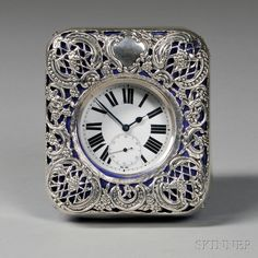 Silver Pocket Watch and an English Sterling Silver-mounted Watch Hutch, the watch with large Roman numerals and subsidiary seconds dial, Swiss silver hallmarks to inside of case,  the hutch of repousse silver overlay on royal blue velvet, marks for London, 1898, William Comyns & Sons.