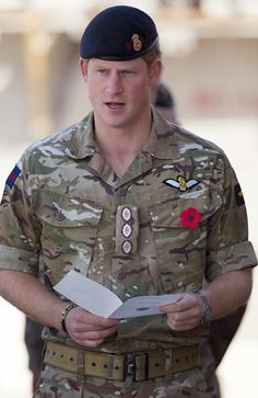 Prince Harry joins British troops and service personal remaining in Afghanistan and also International Security Assistance Force  personnel and civilians as they gather for a Remembrance Sunday service on 09.11.2014 in Kandahar, Afghanistan