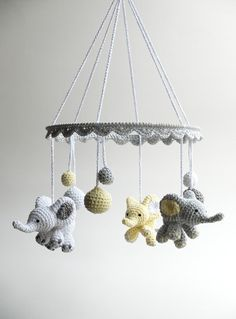 This lovely crochet baby mobile with cute baby elephants, little good luck…