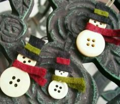 Snowmen from buttons . Adorable.  If you're making alot use felt strips.  If not, paper