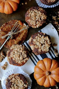 pumpkin nutella swirl muffins with pumpkin spice crumble topping.