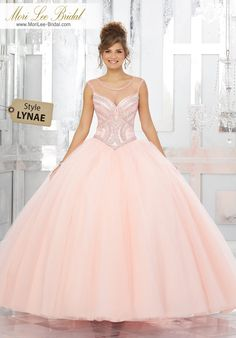 Style LYNAE Jewel Beaded Bodice on a Tulle Ball Gown  Tulle Quinceañera Dress Featuring a Gorgeous Beaded Bodice and Illusion Neckline. A Delicately Beaded Full Skirt and Keyhole Corset Back Complete the Look. Matching Stole Included. Colors Available: Blush, Capri, Light Purple, White.