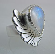 Handcrafted Rainbow moonstone statement cocktail ring with a tear drop shaped stone set in a wing form in size 7.5. $140.00, via Etsy.