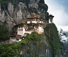 Jeremy Chu Tiger's Nest Monastery, Bhutan Precariously situated on a rock outcropping some 2,600 feet above the Paro Valley (which is itself about 7,000 feet above sea level), Paro Taktsang—or the Tiger's Nest Monastery—is a breathtaking sight. Dating from 1692, the complex is built around a cave where the Indian Guru Rinpoche is said to have meditated in the 8th century. This remote agglomeration of rock formation and man-made monastery is one of Bhutan's most sacred shrines.
