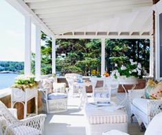 White wicker on the beach porch is always perfect! Add Madras cushions for color.