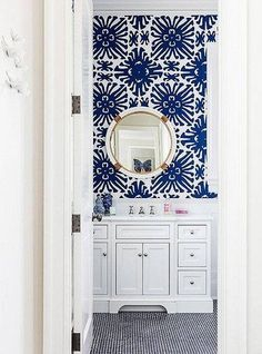 to Go Bold in a Small Bathroom Bold blue and white bathroom with coordinating colors of penny tiles and patterned wallpaper.Bold blue and white bathroom with coordinating colors of penny tiles and patterned wallpaper. Diy Bathroom Remodel, Bathroom Interior, Budget Bathroom, Bathroom Remodeling, Bathroom Makeovers, Apartment Interior, Remodeling Ideas, Apartment Living, Kitchen Remodel