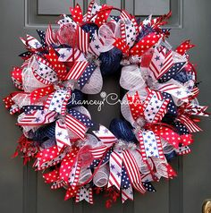 4th of July Wreath, Memorial Day Wreath, Patriot Day Wreath, Veterans Day Wreath, Independence Day Wreath Celebrate freedom with this Red White and Blue, Patriotic Wreath. Constructed on a wire wreath frame with three different styles of Poly Deco Mesh: Metallic Navy/Royal, White FOIL and Deluxe Red & White Stripe Poly Deco Mesh. Four different coordinating patters of wire ribbon are layered throughout this handcrafted wreath. Red glitter picks and rope provide the fireworks on this...