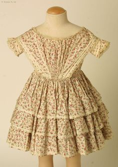 1855-1860 Floral dress trimmed with bias tape