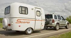 These tiny Scamp trailers make me feel all funny inside. adorable. efficient. practical. dang cute!