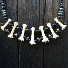 Real Animal Bone Necklace with Seven Bones Featuring Hematite Gothic Sexy Tribal  100. $58.00, via Etsy.