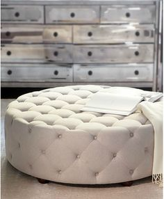 Quilted ottoman and mirrored dresser. This is what I want in my walk-in closet someday