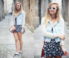 the floral pattern dress looks good with the white faded jean vest .....and the vans are pretty cool