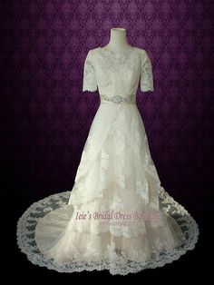 Beautiful modest lace wedding dress with short sleeves by Ieie's Bridal Dress.