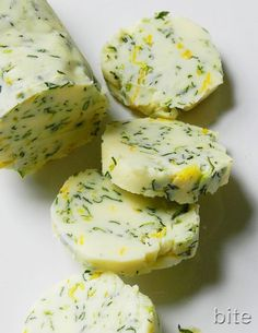 Chive and Lemon Zest Butter - fun for dinner party 1/2 cup salted butter, softened 1/4 cup fresh chives, snipped 1 lemon, zested Mix ingredients together Place herbed butter on waxed paper and roll paper up into a log shape Twist off each end to secure the butter and place in refrigerator until hardened.