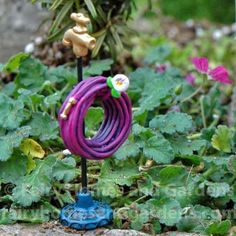 Fairy Homes and Gardens - Miniature Garden Hose Stand, $6.79 (https://www.fairyhomesandgardens.com/miniature-garden-hose-stand/)