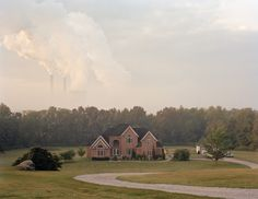 mcmansions in Cheshire, Ohio, with a coal-fired power plant in the distance.