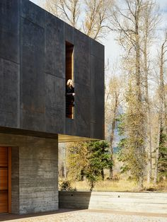 Riverbend's material palette combines cedar and glazing wrapped in a steel plate shell. Over time, the steel will develop a patina; ultimately the building will exchange its black shell for a rusty one, further integrating into the site. Residential architecture by CLB in Jackson, Wyoming – Bozeman, Montana. #architecture #design #mountainmodern #residentialarchitecture Light Architecture, Residential Architecture, Board Formed Concrete, Mountain Home Exterior, Weathering Steel, Mountain Modern, Corten Steel, Architect Design, Planer