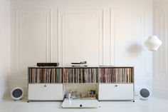 A USM credenza holds vinyl and booze. Music flows via a  Pro-Ject Debut III turntable, a pair of Elipson Planet L speakers, and a Music Hall Audio amplifier.