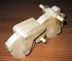 Woodworking Patterns A free woodworking plan for a toy motorcyle. A rugged and fun free motorcycle plan Kids Woodworking Projects, Woodworking Organization, Woodworking Patterns, Woodworking Projects Plans, Wood Projects, Learn Woodworking, Woodworking Videos, Intarsia Wood Patterns, Wood Carving Patterns